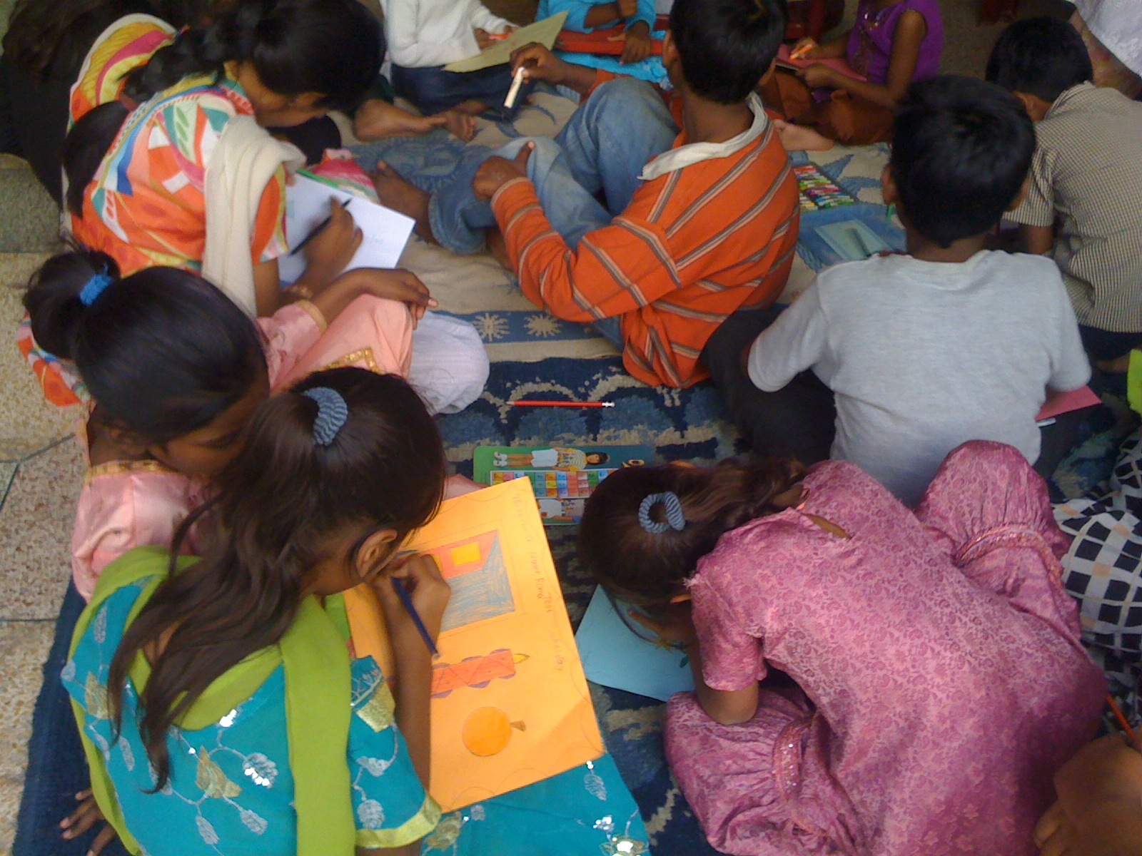 A few of the 33 children taking a break from learning to read Urdu and English, and drawing pictures